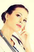 Thinking medical doctor , isolated on white background
