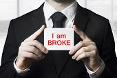 Businessman Holding Sign I Am Broke