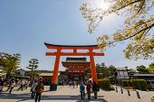KYOTO, JAPAN - APRIL 27th : Sunny with the torii and main hall of Fushimi Inari Taisha Shrine in Kyoto, Japan on 27th April 2014.