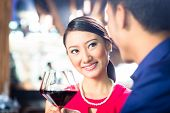 Close up of young couple toasting with wine