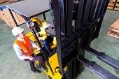 picture of lift truck  - Asian fork lift truck driver discussing checklist with foreman in warehouse  - JPG