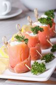 Finger Food. Rolls Of Salmon Closeup On The Table Vertical