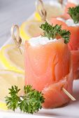 Rolls With Salmon And Cream Cheese On A White Plate Macro