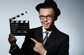 Man with movie clapperboard and hat