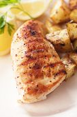 Grilled chicken breast with roasted potato and lemon