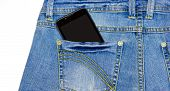 Smart Phone Is In The Pocket Of Blue Jeans