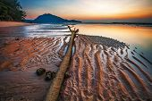 Tropical beach in ebb time on sunset background