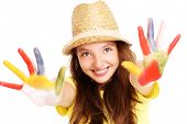 A picture of a joyful girl with paint on her hands