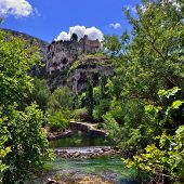 stock photo of century plant  - Beautiful Medieval Village Fontaine de Vaucluse and its castle on the river shore Provence France - JPG