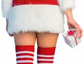 Pretty girl in santa outfit holding gift on white background