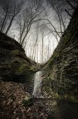 Waterfall on cliffs in forest