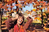 Happy smiling woman portrait in autumn park.