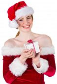 Pretty girl in santa costume holding gift box on white background