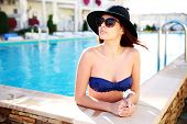 Portrait of a beautiful woman standing in swimming pool