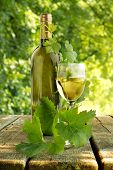 white wine on wooden table