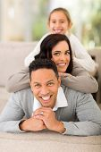 cheerful family pyramid on couch at home