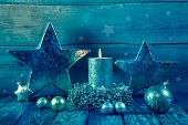 First Advent: One Burning Golden Candle On A Wooden Background.