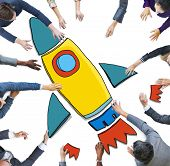 Group of Business People Reaching for Rocket Symbol