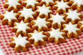 christmas star cookies on checkered tablecloth