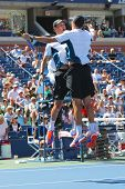 Grand Slam champions Mike and Bob Bryan celebrating victory after semifinal doubles match at US Open