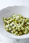 Spinach farfalle in a ceramic bowl