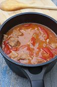 Stew With Tomatoes, Red Bell Pepper In Sauce With Spices In A Saucepan.
