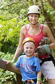 Family enjoying a Zip line Adventure on Vacation