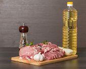 Fresh Raw Pork On Light Wooden Cutting Board