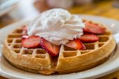 Waffle Topped With Strawberries And Whipped Cream