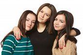 three girlfriends on a white background