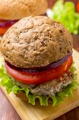 stock photo of whole-grain  - Healthy Chicken Hamburger with a Whole Grain Bun and Vegetables - JPG