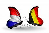 Two Butterflies With Flags On Wings As Symbol Of Relations Holland And Belgium