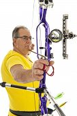 stock photo of longbow  - Man with yellow shirt and jeans holding a longbow in closeup - JPG