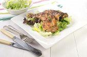 Thyme Chicken Drumsticks On Salad