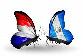 Two Butterflies With Flags On Wings As Symbol Of Relations Holland And Guatemala