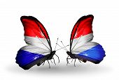 Two Butterflies With Flags On Wings As Symbol Of Relations Holland And Luxembourg