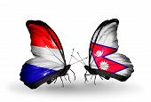picture of holland flag  - Two butterflies with flags on wings as symbol of relations Holland and Nepal - JPG