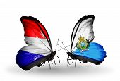 Two Butterflies With Flags On Wings As Symbol Of Relations Holland And San Marino