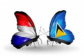 Two Butterflies With Flags On Wings As Symbol Of Relations Holland And Saint Lucia
