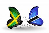 Two Butterflies With Flags On Wings As Symbol Of Relations Jamaica And  Botswana