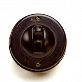pic of bakelite  - Old Vintage bakelite light switch isolated against white background from low perspective - JPG