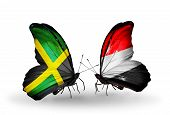 Two Butterflies With Flags On Wings As Symbol Of Relations Jamaica And Yemen