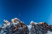 The Moon Is Shining Behind A Peak