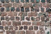 stock photo of slag  - Detail of an old slag stone wall - JPG