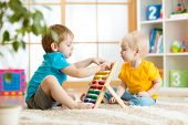 foto of indoor games  - children boys play with abacus toy indoors - JPG