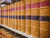 Close up of a shelf of old books in library