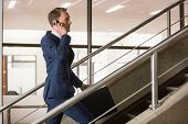 Handsome businessman on the phone in office building