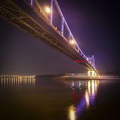 Illuminated pedestrian bridge on the Dnieper River Kiev Ukraine