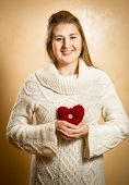 Smiling Woman Holding Big Red Knitted Heart