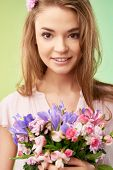 Gorgeous girl with bouquet of flowers